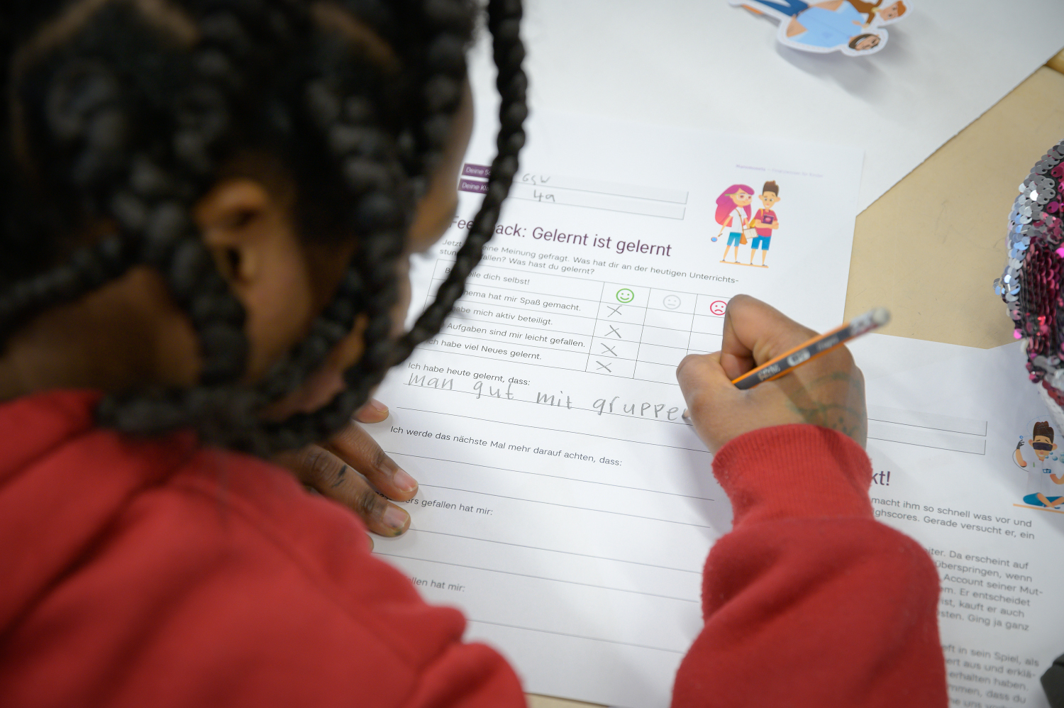 Financial education for children: Child completes a feedback form on the finlit initiative.